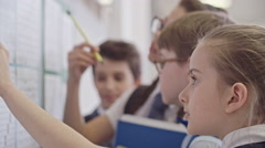 Schoolchildren Looking at New Timetable before Classes Stock Footage