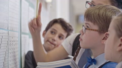 Schoolchildren Studying New Term Timetable Stock Footage