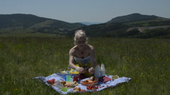Lady on Picnic Tearing apart Croissant Stock Footage