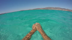 Swimming in blue lagoon, point of view shot. Stock Footage