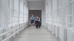 School Students Walking Along Hallway Stock Footage
