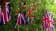UNION JACK FLAGS BLOWING THE MALL LONDON ENGLAND Stock Footage