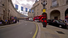 RED BUSES TRAFFIC REGENT STREET LONDON ENGLAND Stock Footage