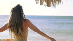 Happy young woman with pareo on the beach. Close-up. HD Stock Footage