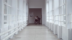 Excited Schoolchildren Running in Hallway Stock Footage