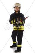 Junge Feuerwehrfrau in Uniform mit Wasserspritze Stock Photos