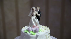 Figurines of the bride and groom on the cake Stock Footage