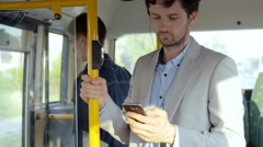 Man starting daily commute with phone Stock Footage