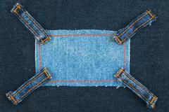 Frame made of denim with four straps of jeans, lies on the dark denim, Stock Photos