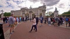 TOURISTS CROSSING ROAD BUCKINGHAM PALACE LONDON Stock Footage