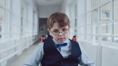 Schoolboy in Wheelchair Riding to Lessons Stock Footage