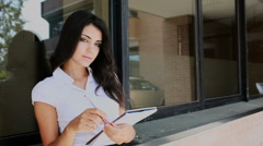 Young secretary woman work with red pen and paper Stock Footage