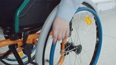 Boy Riding Wheelchair in Closeup Stock Footage