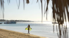 The young woman is running along the beach with pareo. HD Stock Footage