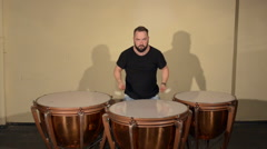One Man With a Beard in Black T-Shirt, Playing on the Percussion Instrument Stock Footage