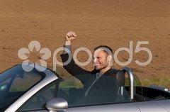 Erfolgreicher Geschäftsmann im Cabrio Stock Photos