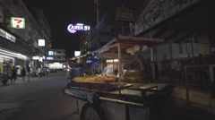 Asian Woman selling pushing food cart on alley street Stock Footage