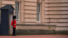 BUCKINGHAM PALACE QUEENS GUARDSMAN MARCHING LONDON Stock Footage