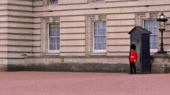 BUCKINGHAM PALACE QUEENS GUARDSMAN LONDON ENGLAND Stock Footage