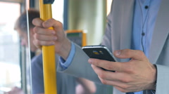 Commuter with phone in the bus Stock Footage