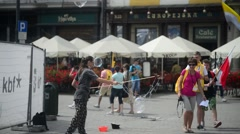 Krakow Market Square, tourists, walk and having fun with  bubbles Stock Footage