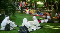 Old Town Krakow Park - Nuns, Sisters of Mercy Have Rest, Relaxing On The Shadow Stock Footage