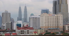 By rail passes train. In the background seen Petronas Twin Towers, hotel and Stock Footage