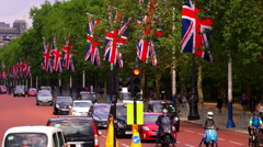 UNION JACK FLAGS TRAFFIC THE MALL LONDON ENGLAND Stock Footage
