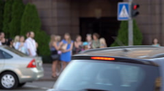 Crowd of pedestrian crossing the street after traffic light signal Stock Footage
