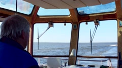 Captain of small ship traveling in the open sea Stock Footage
