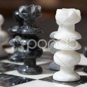 Schachfiguren schwarz und weiß Stock Photos