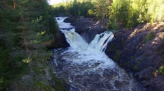 Big beautiful waterfall in the forest. Aerial view. Stock Footage