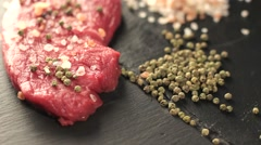 Raw beef meat fillet with peppercorn and thyme and differnt spices in glass Stock Footage