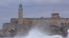The Morro castle and fort in Havana Cuba with large waves breaking foreground. Stock Footage