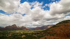 Time Lapse of Cloudscape over Airport Mesa Vortex in Sedona, Arizona -Tilt Up- Stock Footage