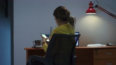 Girl College Student Studying At Night Types Message On Phone Stock Footage