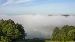 Fog and low clouds over the valley Stock Footage