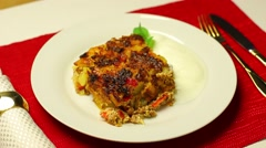 Portion of hot moussaka on plate Stock Footage