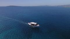 Flying along Greek fishing boat Stock Footage