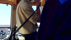Captain cap sailor man talking phone in boat sailing in sea Stock Footage