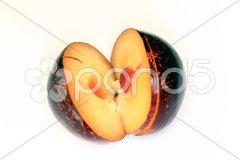 Pflaume aufgeschnitten - Bio Stock Photos
