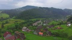 Flight over the mountain village Stock Footage