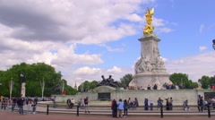 PEDESTRIANS QUEEN VICTORIA MEMORIAL LONDON ENGLAND Stock Footage