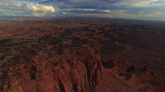 High Descent Towards Desert Cliff and Epic Canyon Vista at Sunset Stock Footage