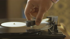 Man playing songs on a record player Stock Footage