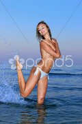Young woman topless in water Stock Photos