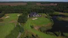 Aerial of golfcourse and clubhouse in summer. Stock Footage