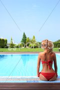 Bikini model in pool with clear blue water Stock Photos