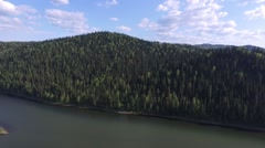 Mountainous terrain crossed by the river / quadrocopter Stock Footage
