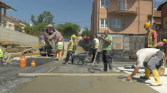 Workers concreting building foundation at sunny day by Sheyno. Stock Footage